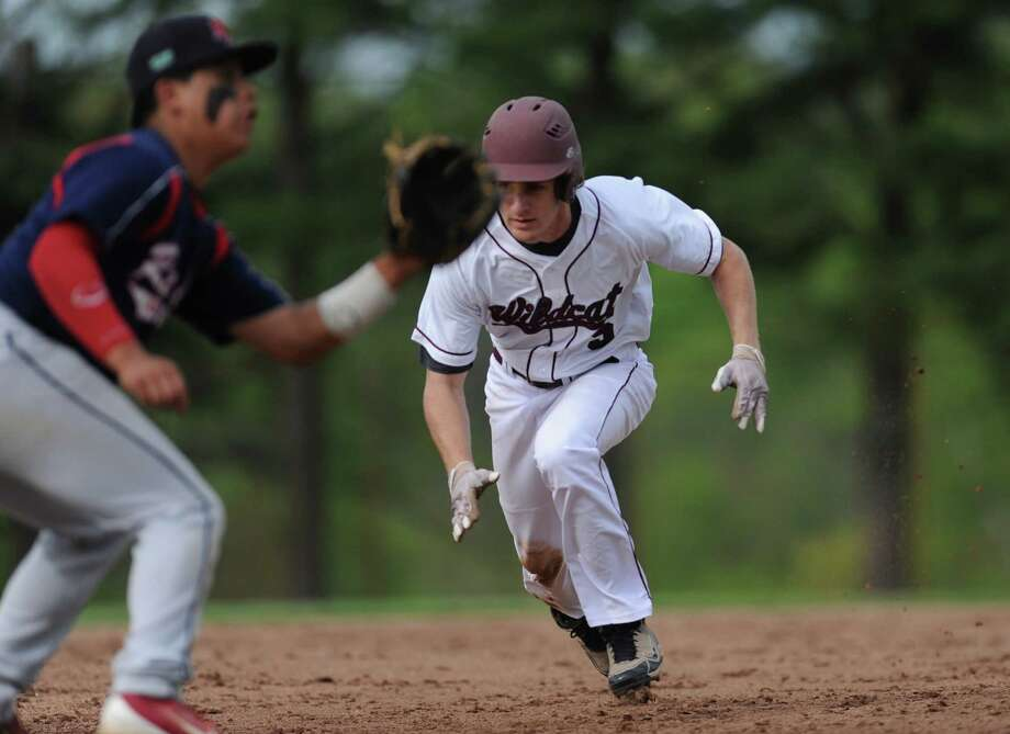 Bethel's Ryan Nuzzo slides into third base, where he is tagged out by New Fairfield third baseman Anthony Latassa during Bethel's 3-1 win over New Fairfield at Bethel High School in Bethel, Conn. on Friday, May 10, 2013. Photo: Tyler Sizemore / The News-Times