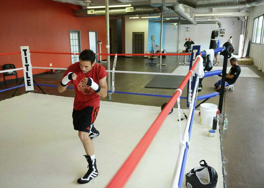 Danbury boxer Delvin Rodriguez trains at his training camp in Danbury, Conn. on Friday, May 10, 2013.  Rodriguez is preparing for his ESPN Friday Night Fights junior middleweight bout with Freddy Hernandez at Mohegan Sun Casino in Montville, Conn. on May 24. Photo: Tyler Sizemore / The News-Times