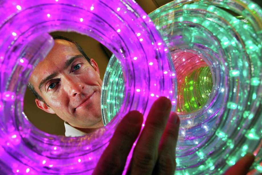 Times Union staff photo by John Carl D'Annibale:  VP for planning and analysis at Evident Technologies of Troy, David Douglas shows off some of their Dotstrand Rope LED lights Wednesday afternoon February 6, 2008.   FOR RUILISON STORY Photo: John Carl D'Annibale / Albany Times Union