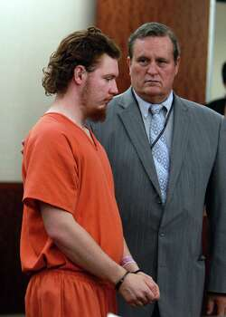 Dylan Andrew Quick, with his lawyer Jules Laird, was arraigned Friday on three charges of aggravated assault in the April 9  campus attacks. Photo: Mayra Beltran, Staff / © 2013 Houston Chronicle