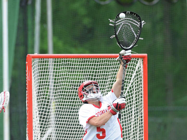 Greenwich goalie Wiliam Waesche makes a stop during the boys high school lacrosse match between Gree