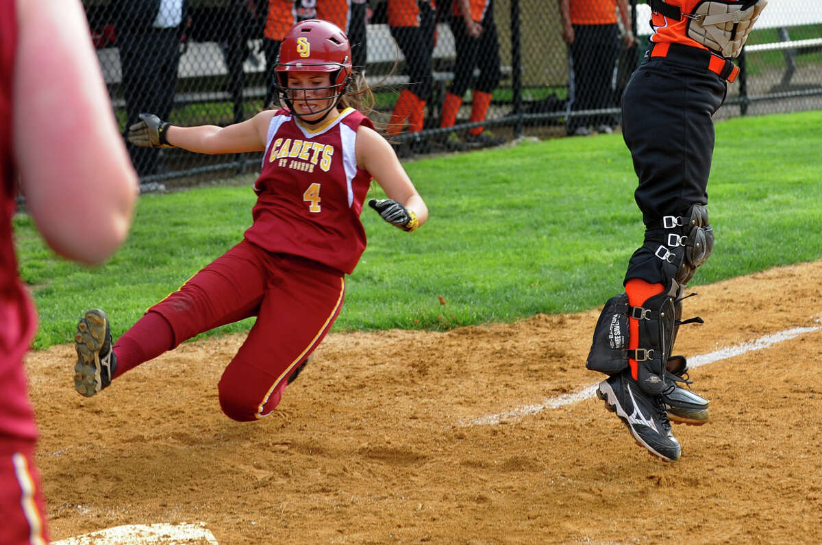 St. Joseph's Amy Chacho slides into home plate to score a run, during softball action against Stamford in Trumbull, Conn. on Friday May 10, 2013.