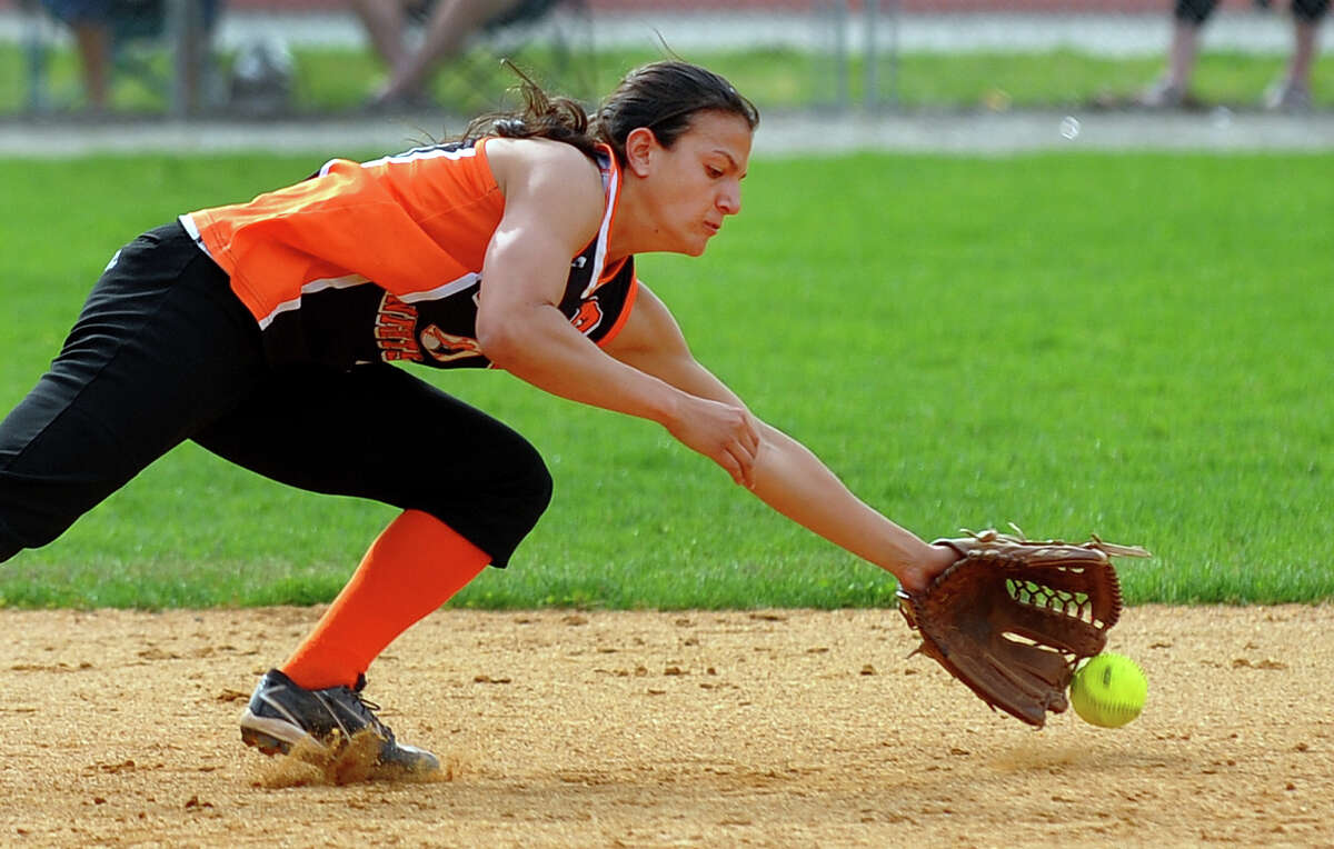 Stamford shortstop Krista Robustelli misses a St. Joseph grounder, during softball action in Trumbull, Conn. on Friday May 10, 2013.