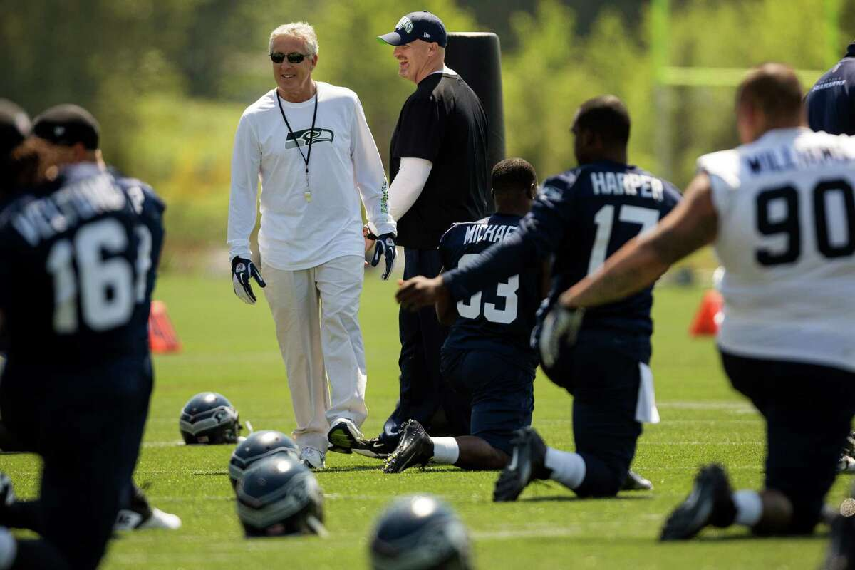 Seahawks head coach Pete Carroll watches over new recruits during first day of drills of the Seahawks Rookie Minicamp Friday, May 10, 2013, at the Virginia Mason Athletic Center in Renton.