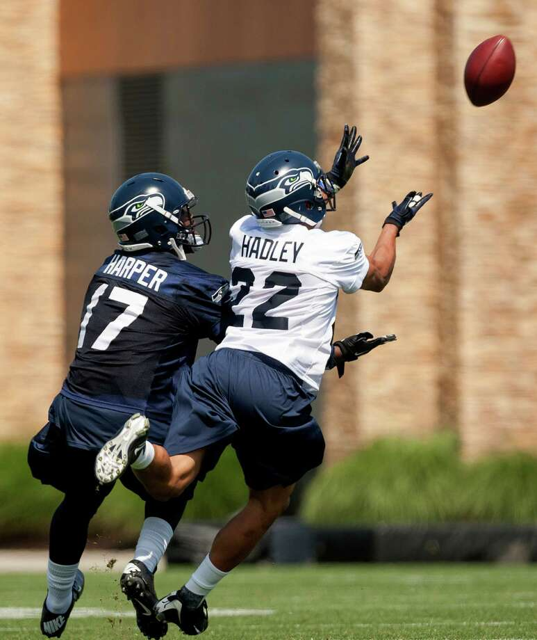 Preston Hadley, center, and Chris Harper, left, go up for a catch during a drill on the first day of the Seahawks Rookie Minicamp Friday, May 10, 2013, at the Virginia Mason Athletic Center in Renton. Photo: JORDAN STEAD, SEATTLEPI.COM / SEATTLEPI.COM
