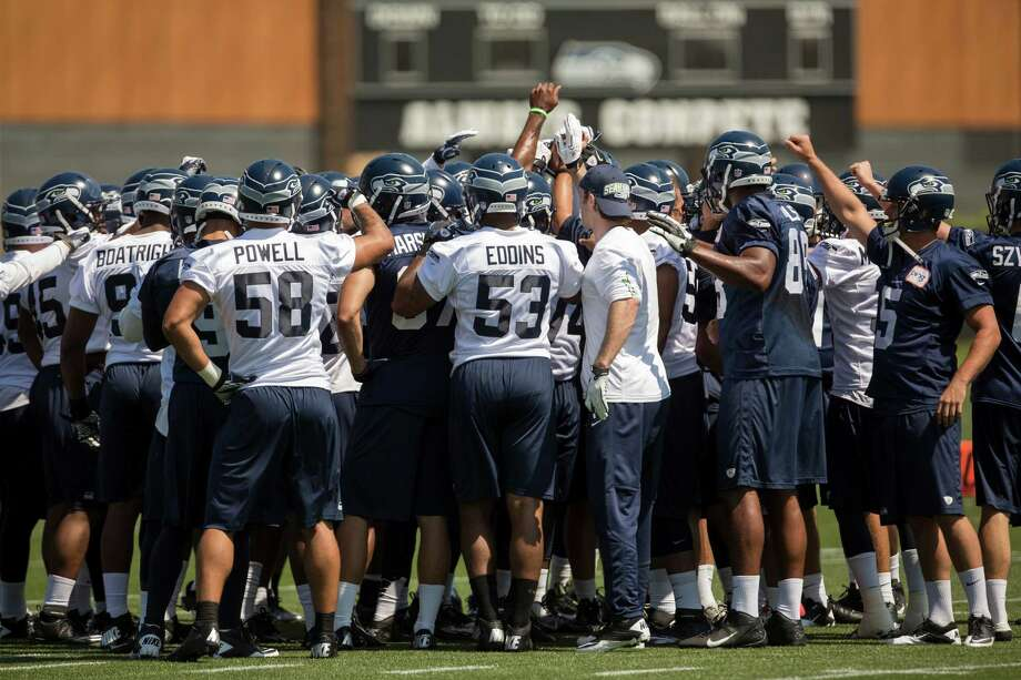 Players huddle up before starting drills on the first day of the Seahawks Rookie Minicamp Friday, May 10, 2013, at the Virginia Mason Athletic Center in Renton. Photo: JORDAN STEAD, SEATTLEPI.COM / SEATTLEPI.COM