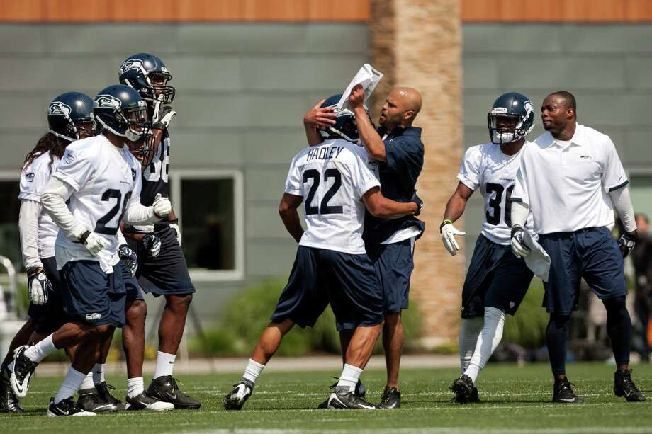 Preston Hadley, center, is congratulated on a solid catch during a drill on the first day of the Seahawks Rookie Minicamp Friday, May 10, 2013, at the Virginia Mason Athletic Center in Renton. Photo: JORDAN STEAD, SEATTLEPI.COM / SEATTLEPI.COM