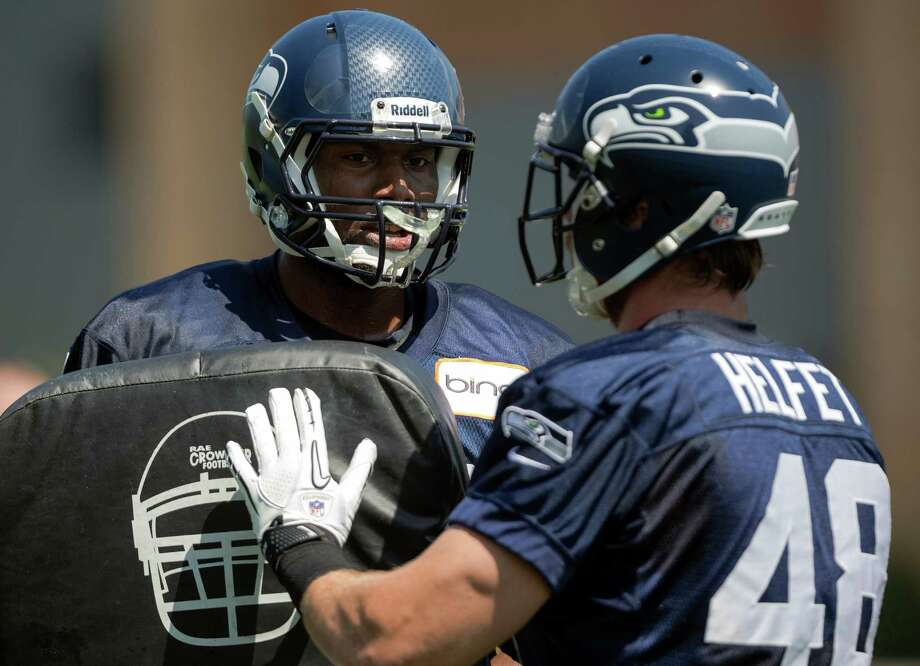 Darren Fells, left, talks with Cooper Helfet, right, during a blocking drill on the first day of the Seahawks Rookie Minicamp Friday, May 10, 2013, at the Virginia Mason Athletic Center in Renton. Photo: JORDAN STEAD, SEATTLEPI.COM / SEATTLEPI.COM