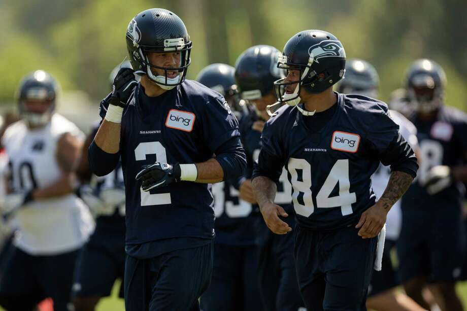 Matt Austin, left, and Austin Coleman, right, jog in for a water break during the first day of the Seahawks Rookie Minicamp Friday, May 10, 2013, at the Virginia Mason Athletic Center in Renton. Photo: JORDAN STEAD, SEATTLEPI.COM / SEATTLEPI.COM