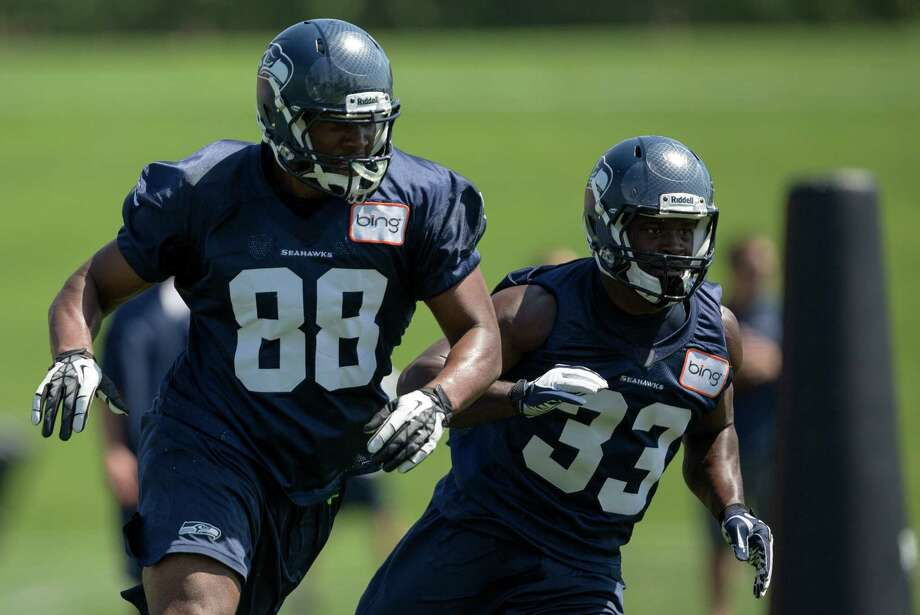 Darren Fells, left, and Christine Michael, right, participate in a running drill on the first day of the Seahawks Rookie Minicamp Friday, May 10, 2013, at the Virginia Mason Athletic Center in Renton. Photo: JORDAN STEAD, SEATTLEPI.COM / SEATTLEPI.COM