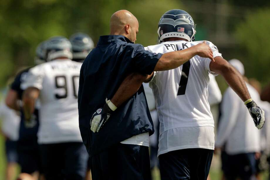 Strong safety Ray Polk, right, is slapped on the back by a coach during the first day of the Seahawks Rookie Minicamp Friday, May 10, 2013, at the Virginia Mason Athletic Center in Renton. Photo: JORDAN STEAD, SEATTLEPI.COM / SEATTLEPI.COM