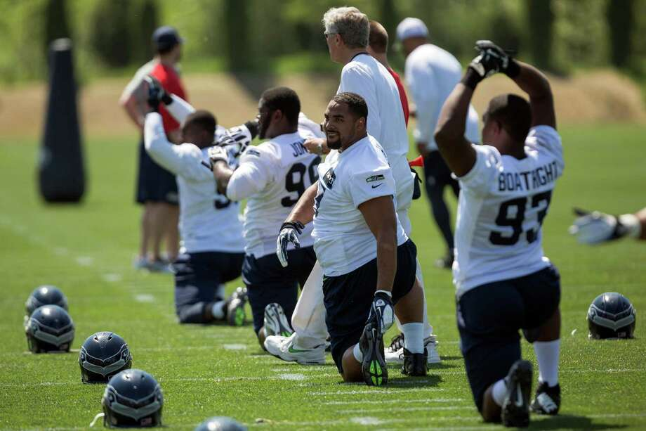 Players warm up and stretch out before the first day of the Seahawks Rookie Minicamp Friday, May 10, 2013, at the Virginia Mason Athletic Center in Renton. Photo: JORDAN STEAD, SEATTLEPI.COM / SEATTLEPI.COM