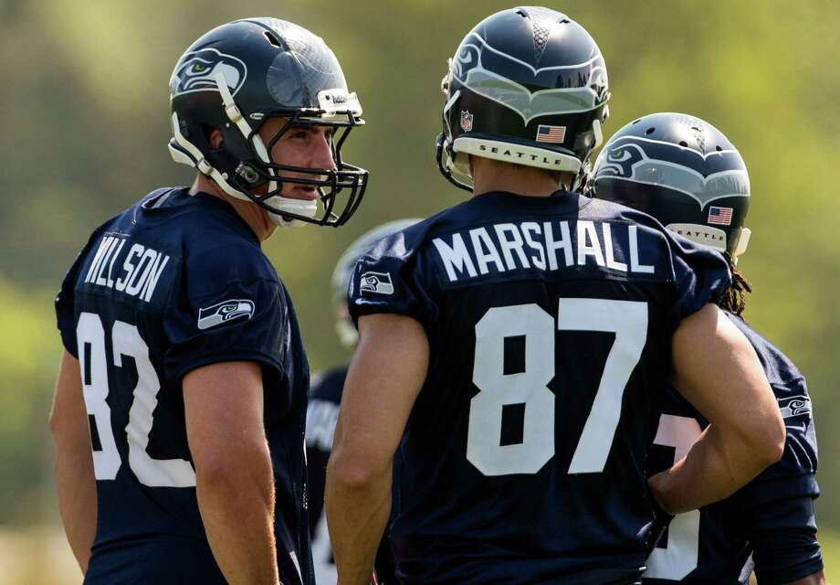 Luke Willson, left, chats with Victor Marshall, center, between drills on the first day of the Seahawks Rookie Minicamp Friday, May 10, 2013, at the Virginia Mason Athletic Center in Renton. Photo: JORDAN STEAD, SEATTLEPI.COM / SEATTLEPI.COM