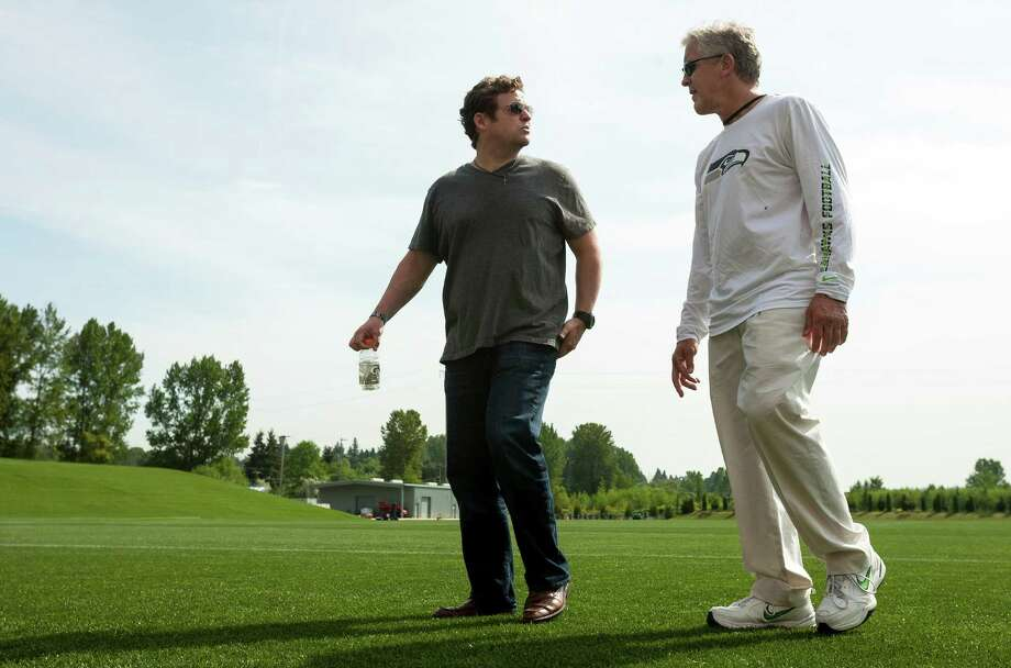 Seahawks head coach Pete Carroll, right, chats with general manager John Schneider, center, following the first day of the Seahawks Rookie Minicamp Friday, May 10, 2013, at the Virginia Mason Athletic Center in Renton. Photo: JORDAN STEAD, SEATTLEPI.COM / SEATTLEPI.COM