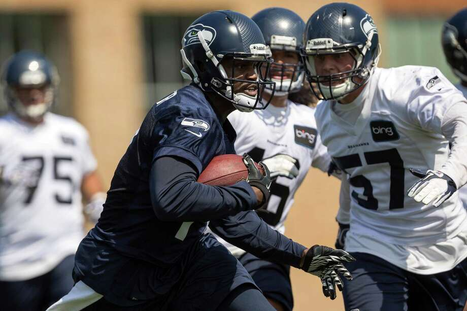Chris Harper, center left, charges through defense during a scrimmage on the first day of the Seahawks Rookie Minicamp Friday, May 10, 2013, at the Virginia Mason Athletic Center in Renton. Photo: JORDAN STEAD, SEATTLEPI.COM / SEATTLEPI.COM