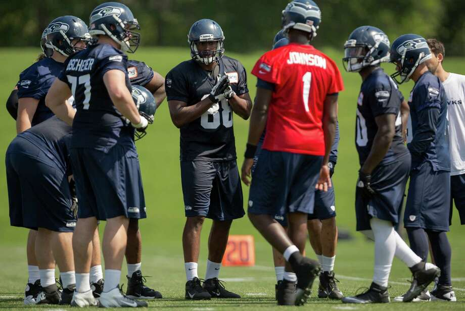 Darren Fells, center left, huddles up with players on the first day of the Seahawks Rookie Minicamp Friday, May 10, 2013, at the Virginia Mason Athletic Center in Renton. Photo: JORDAN STEAD, SEATTLEPI.COM / SEATTLEPI.COM
