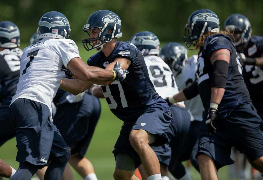 Players clash during a scrimmage on the first day of the Seahawks Rookie Minicamp Friday, May 10, 2013, at the Virginia Mason Athletic Center in Renton. Photo: JORDAN STEAD, SEATTLEPI.COM / SEATTLEPI.COM