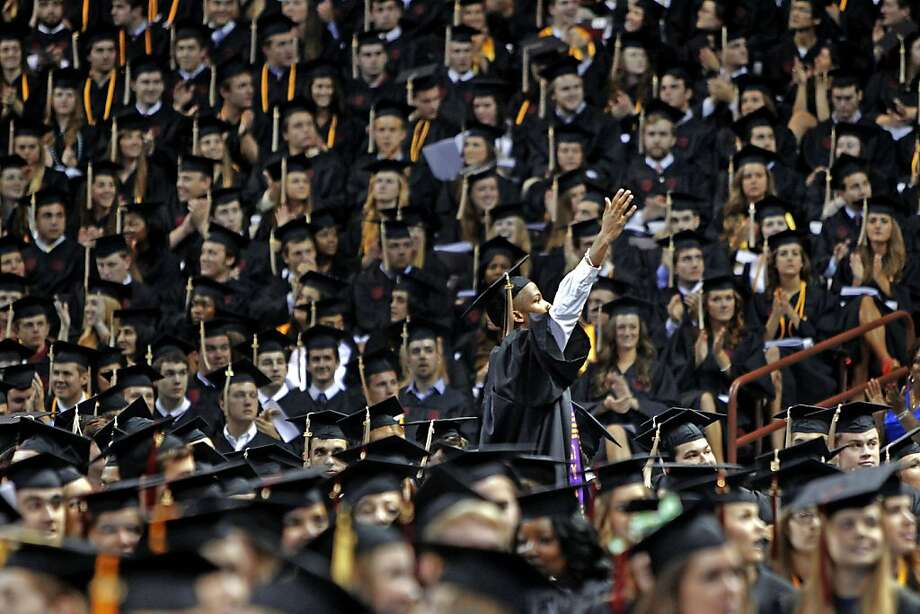 A University of South Carolina graduate looks to his family during the school's commencement ceremony in Columbia, South Carolina, on Friday, May 10, 2013.  Photo: Gerry Melendez, McClatchy-Tribune News Service