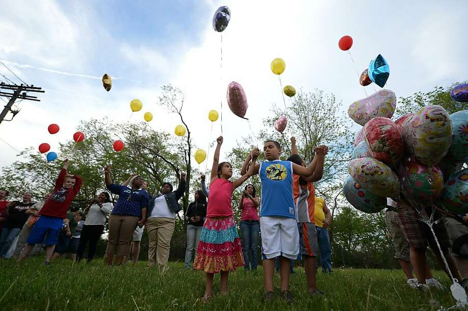 Children release balloons as part of a gathering outside a community meeting at Immanuel Lutheran Church held to talk about the kidnapping of Michelle Knight, Gina DeJesus and Amanda Berry by neighbour resident Ariel Castro, in Cleveland, May 9, 2013 in Cleveland, Ohio.  Photo: Emmanuel Dunand, AFP/Getty Images