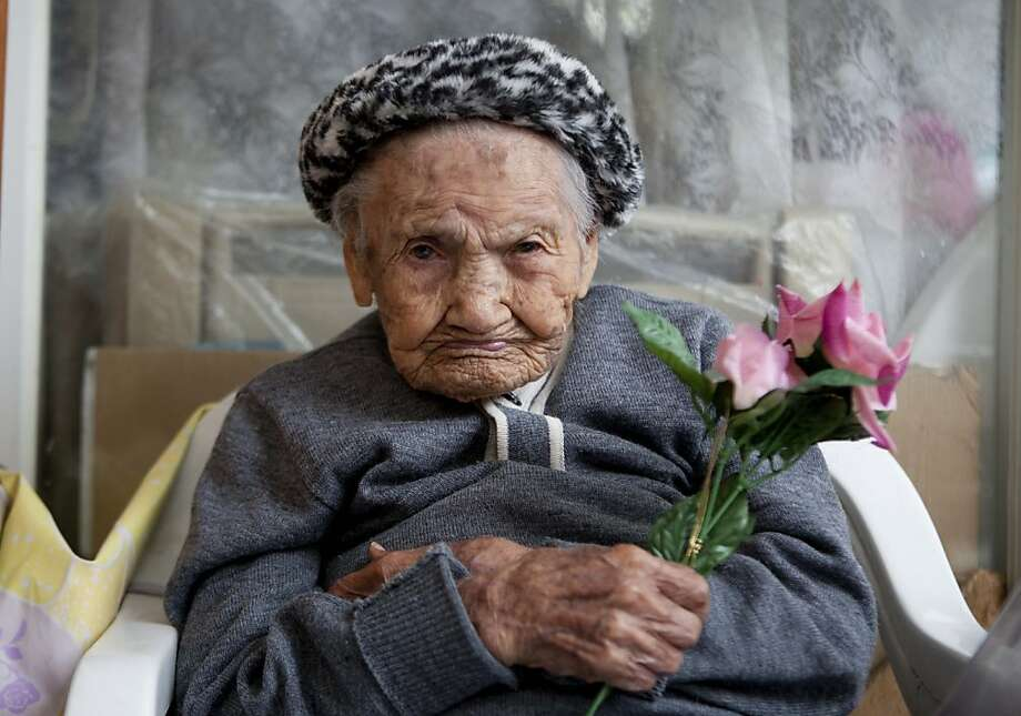 Amalia Lopez, who is 114-years-old, poses for a portrait inside her home on Mother's Day in Mexico City, Friday, May 10, 2013. Lopez was honored by the city on Mother's Day for being the oldest living woman in Mexico City. Lopez has survived her four children, and has 15 grandchildren and three great-grandchildren. Lopez was born on July 10, 1898, and will turn 115 this July 10.  Photo: Eduardo Verdugo, Associated Press