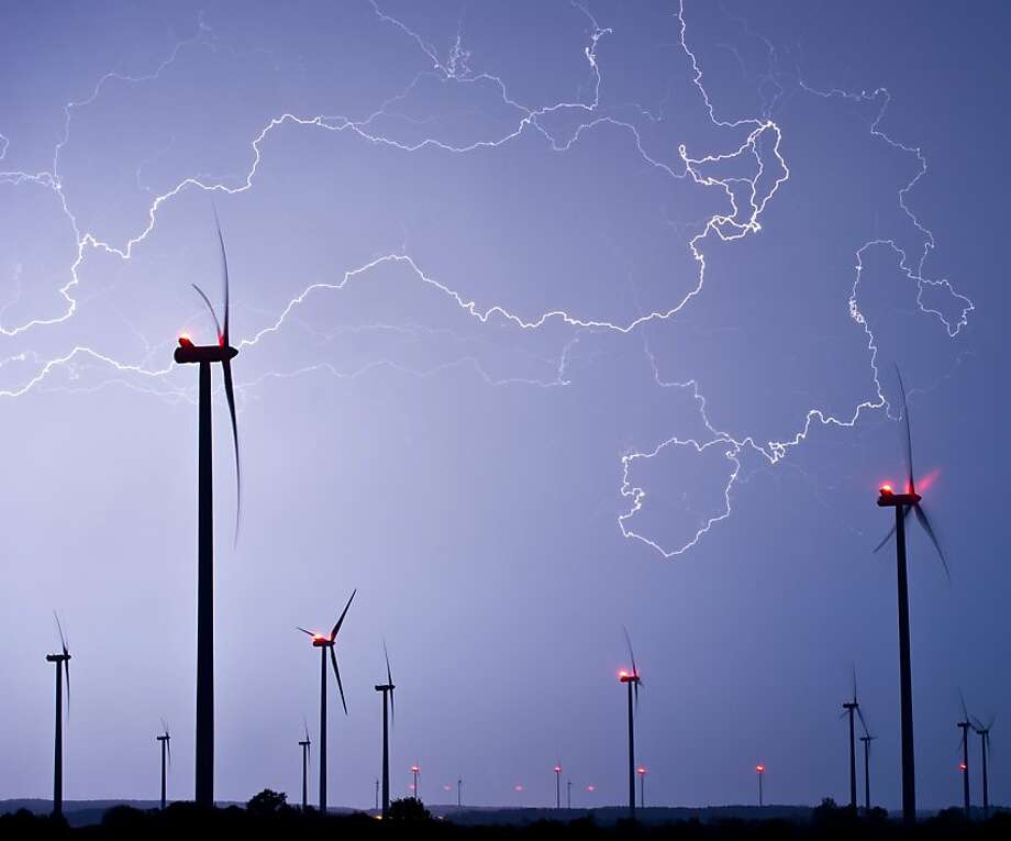 In this picture made available Friday, May 10, 2013, flashlights light the sky over a wind energy park during a thunderstorm near Jacobsdorf, eastern Germany, Thursday, May 9, 2013.  Photo: Patrick Pleul, Associated Press