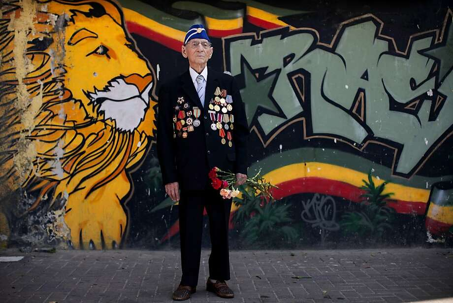 Russian-Israeli World War II veteran poses for a photograph during a street parade, not pictured, marking Victory day in Haifa, Israel, Friday, May 10, 2013. Israeli World War II veterans from the former Soviet Union marched together with their families in Haifa Friday to celebrate the 68th anniversary of the Allies victory over Nazi Germany in 1945.  Photo: Oded Balilty, Associated Press