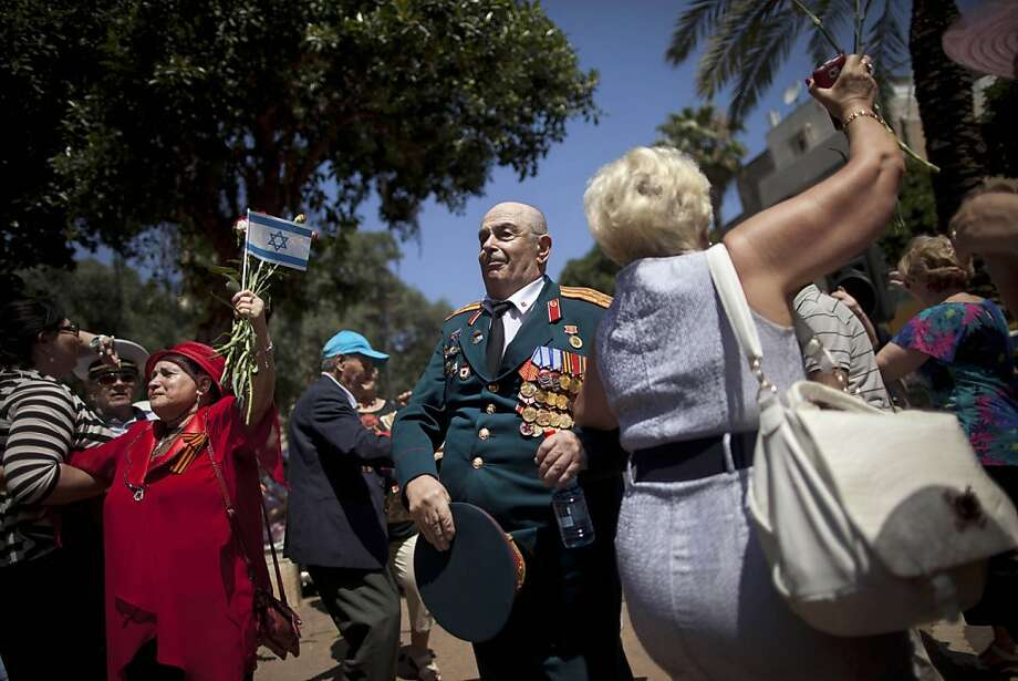 Russian-Israeli World War II veterans dance during a street parade marking Victory day in Haifa, Israel, Friday, May 10, 2013. Israeli World War II veterans from the former Soviet Union marched together with their families in Haifa Friday to celebrate the 68th anniversary of the Allies victory over Nazi Germany in 1945.  Photo: Oded Balilty, Associated Press
