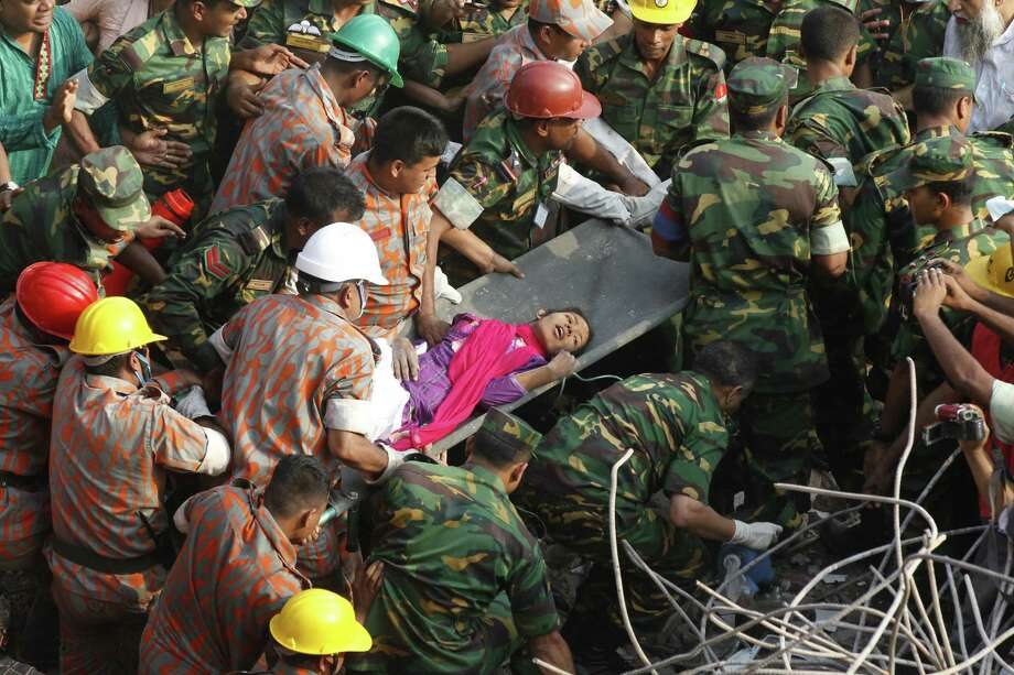 Bangladeshi rescuers carry garment worker Reshma from the rubble of a collapsed building in Savar on Friday, 17 days after the eight-story building collapsed. Photo: AFP / Getty Images