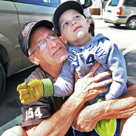 Jerry Couser of Waterford holds his grandson Lucas Pace, 3, of Colonie as they watch as demolition continues on the former St. Patrick's Church in Watervliet, NY Friday May 10, 2013.  (John Carl D'Annibale / Times Union) Photo: John Carl D'Annibale / 00022324A
