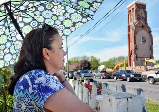Angela Mastan of Citizens for St.Patricks watches as demolition continues on the former St. Patrick's Church in Watervliet, NY Friday May 10, 2013.  (John Carl D'Annibale / Times Union) Photo: John Carl D'Annibale / 00022324A