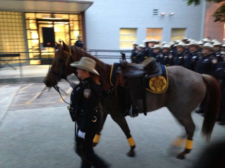 A Harris County Sheriff's deputy leads a riderless horse past the reviewing stand at the Harris County Peace Officers' Memorial Ceremony.  Photo by Mike Glenn Photo: Mike Glenn / Houston Chronicle