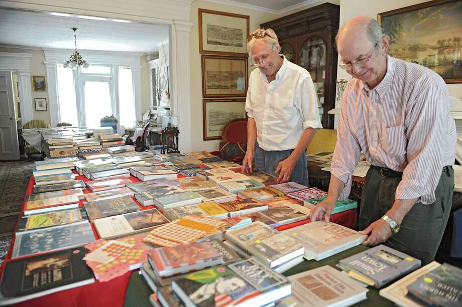 From left, board member John Connors and David Saehrig, trustee of the Lansingburgh Historical Society, arrange used books at the Herman Melville House on Friday, May 10, 2013 in Troy, N.Y. The historical society is getting ready for Saturday's book sale to benefit restoration of the Herman Melville House. (Lori Van Buren / Times Union) Photo: Lori Van Buren / 00022372A