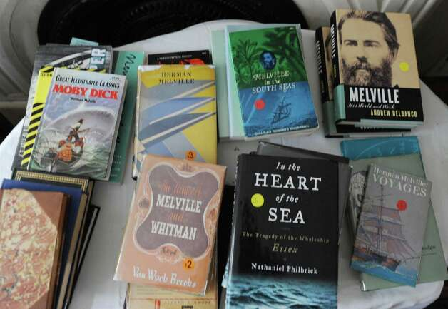 Some of Herman Melville's books will be for sale Saturday at the Herman Melville House on Friday, May 10, 2013 in Troy, N.Y. The Lansingburgh Historical Society is getting ready for Saturday's book sale to benefit restoration of the Herman Melville House. (Lori Van Buren / Times Union) Photo: Lori Van Buren / 00022372A