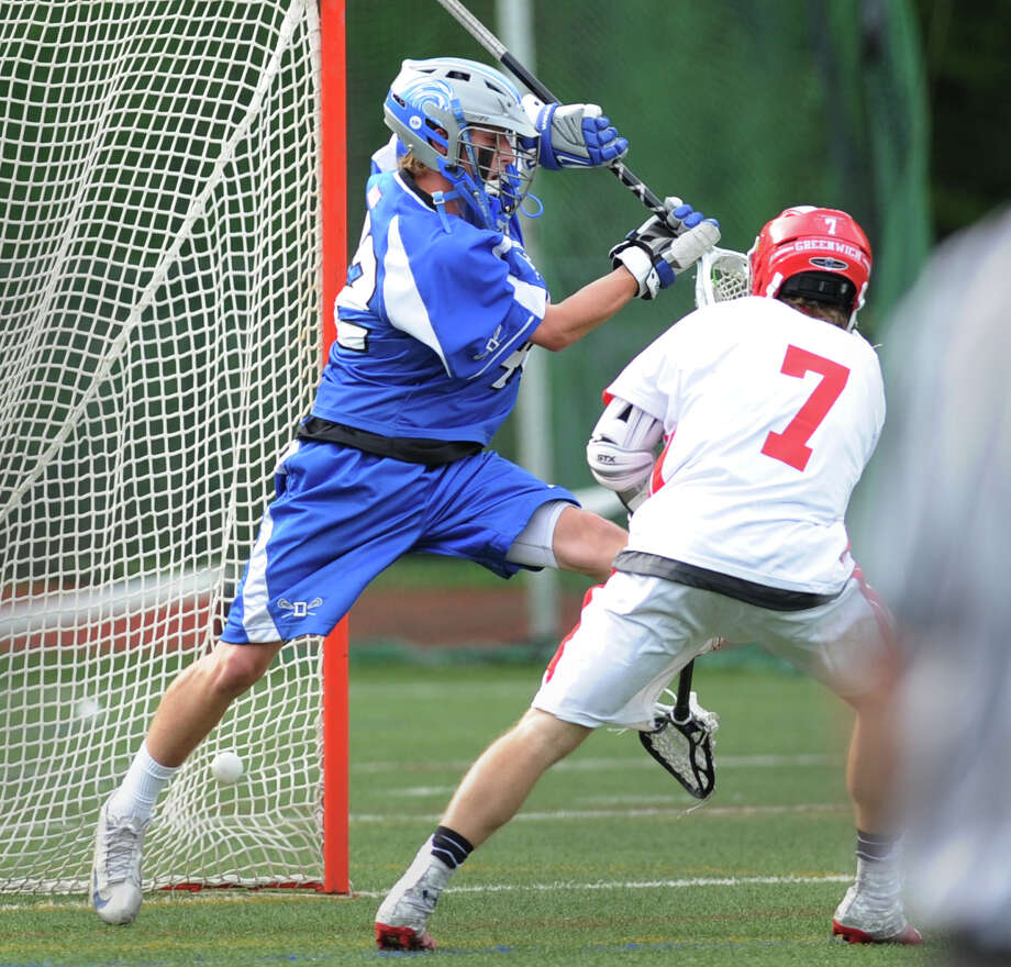 Darien goalie Phil Huffard, left, is unable to make the save on a goal by Jamie Paradise (# 7) of Greenwich during the boys high school lacrosse match between Greenwich High School and Darien High School at Greenwich, Friday, May 10, 2013. Greenwich defeated Darien, 8-6. Photo: Bob Luckey / Greenwich Time