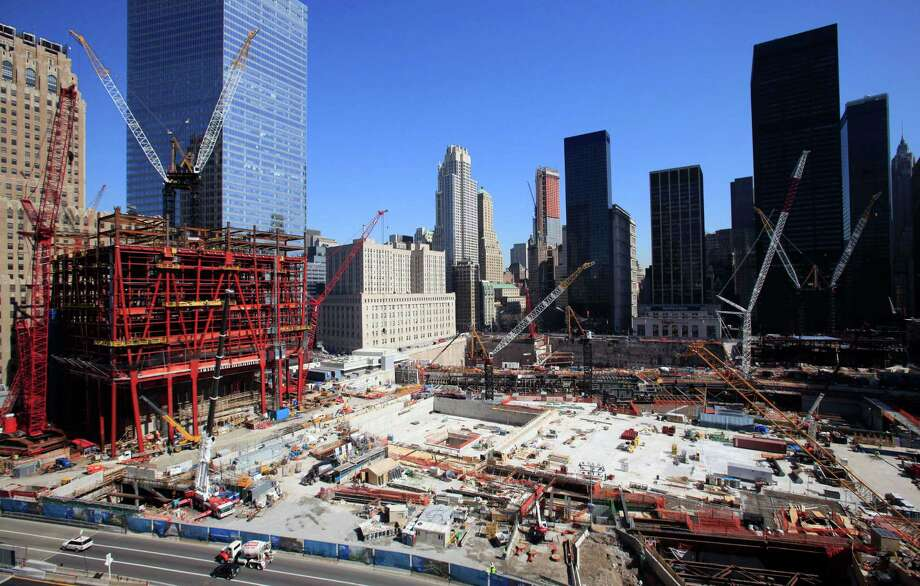 In this March 17, 2010 file photo, cranes stand at the construction site of One World Trade Center, left, and World Trade Center Tower 4, right, in New York. One WTC is being built by the Port Authority of New York and New Jersey, while Tower 4 is one of three towers to be built by developer Larry Silverstein. Photo: Mark Lennihan, Associated Press / AP