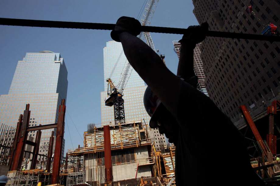 """In this July 29, 2008 file photo, an ironworker carries a piece of steel at the """"Freedom Tower"""" construction site in New York. One World Trade Center is at the northwest corner of the site where the twin World Trade Center towers were destroyed in the Sept. 11, 2001, terrorist attacks. Photo: Mark Lennihan, Associated Press / AP"""