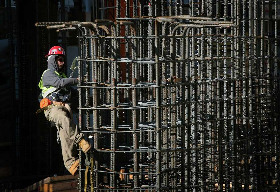 In this Oct. 22, 2008 file photo, a construction worker ties together steel reinforcing bars at the World Trade Center site in New York. Photo: Mark Lennihan, Associated Press / AP