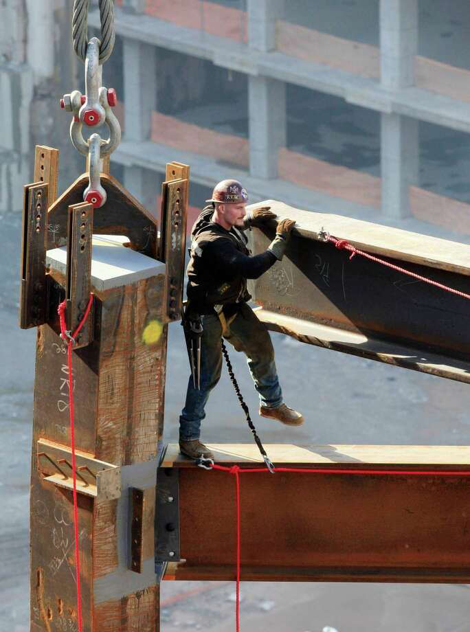 In this March 19, 2010 file photo, an ironworker maneuvers a steel beam suspended from a crane at One World Trade Center in New York. Photo: Mark Lennihan, Associated Press / AP