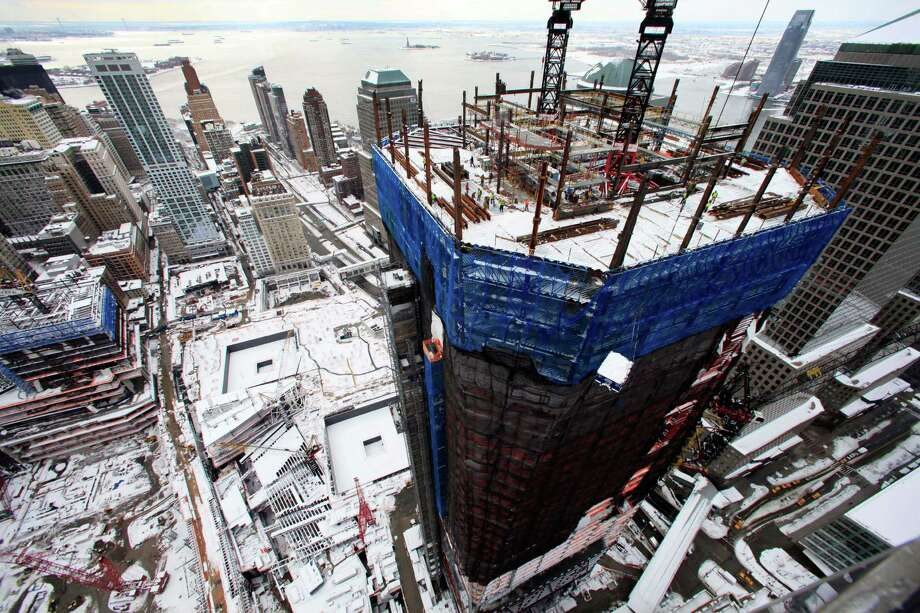 In this Jan. 27, 2011 file photo, snow covers the World Trade Center construction site in New York. The tower under construction at right is One World Trade Center. Photo: Mark Lennihan, Associated Press / AP