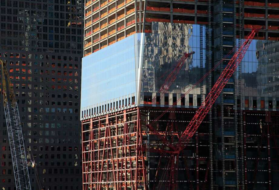 In this Wednesday, Feb. 16, 2011 photo, panels of windows are installed over the steel framework of One World Trade Center in New York. Photo: Mark Lennihan, Associated Press / AP