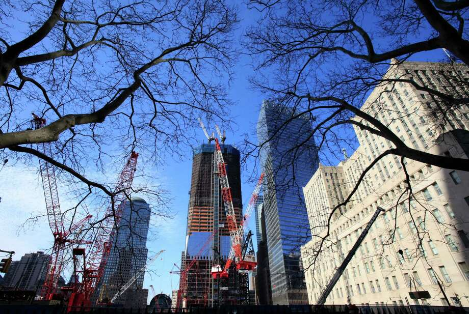 In this Feb. 16, 2011 file photo, work continues on One World Trade Center, center, in New York. Photo: Mark Lennihan, Associated Press / AP