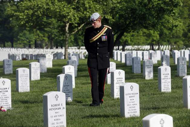 England's Prince Harry visits Section 60 at Arlington National Cemetery, Friday, May 10, 2013. The British soldier-prince is spending most of his week in the U.S. honoring the wounded and the dead of war. Photo: Charles Dharapak, Associated Press / AP