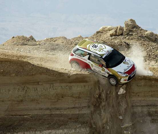 A handout picture released by the Jordan Rally shows Abu Dhabi Racing's Emirati driver Mohammed al-Sahlawi and his Irish co-driver Allan Harryman veering off a cliff during the first stage of the Jordan Rally, round three of the FIA Middle East Rally Championship, in Sweimeh near the Dead Sea on May 10, 2013. The drivers escaped unhurt. Photo: HO, AFP/Getty Images / AFP