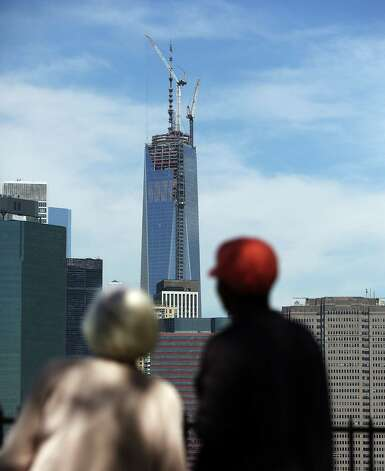 One World Trade Center, now the tallest building in the United States, is viewed on May 10, 2013 in New York City. After more than 11 years of construction and planning, One World Trade Center reached its final height Friday morning of 1,776 feet. When it opens for business in 2014, One World Trade center will be home to companies including Conde Nast and Vantone Holdings China Center. One World Trade Center is built on the site where the September 11, 2001 attacks toppled the original World Trade Center towers. Photo: Spencer Platt, Getty Images / 2013 Getty Images