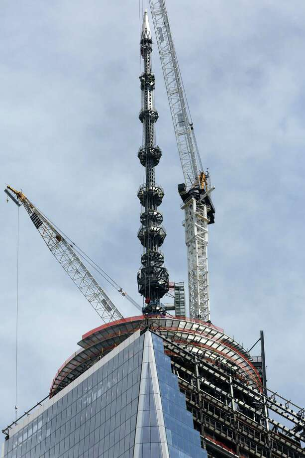 The 408-foot spire at the top of One World Trade Center is seen from lower Manhattan, Friday, May 10, 2013.  The tall, heavy spire was fully installed Friday, bringing One World Trade Center to its symbolic height of 1,776 feet. Photo: Mary Altaffer, AP Photo/Mary Altaffer / Associated Press