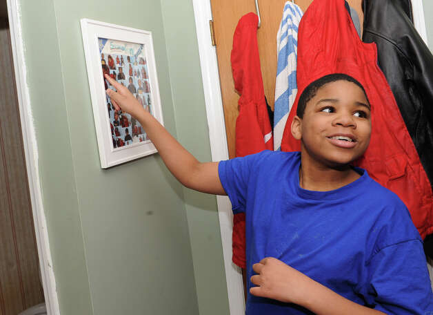 Matthew Bloom, 11, points to a baby photo of himself on a wall in his home on Monday Feb. 4, 2013 in Selkirk, N.Y.  (Lori Van Buren / Times Union) Photo: Lori Van Buren