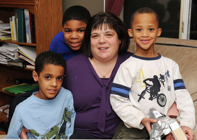 Amie Bloom with her sons David, 9, bottom left, Matthew, 11, top left, and Jacob, 6, right, at their home on Monday Feb. 4, 2013 in Selkirk, N.Y.  (Lori Van Buren / Times Union) Photo: Lori Van Buren