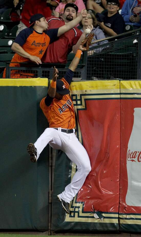 Jimmy Paredes of the Astros is unable to spoil a home run from Jeff Baker of the Rangers during the seventh inning.