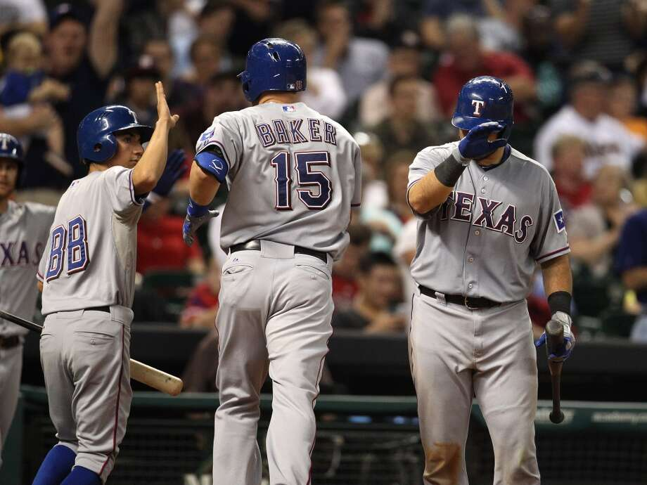 Rangers right fielder Jeff Baker celebrates his home run in the seventh inning