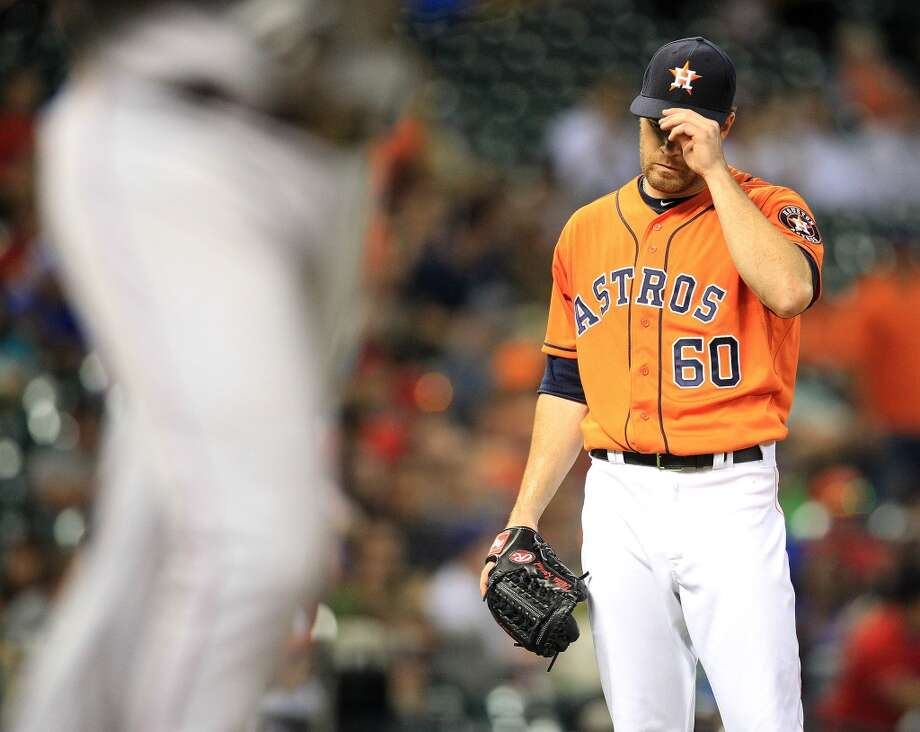 May 10: Rangers 4, Astros 2 Astros pitcher Alex Keuchel reacts after walking Elvis Andrus of the Rangers with the bases loaded. Photo: Karen Warren, Houston Chronicle